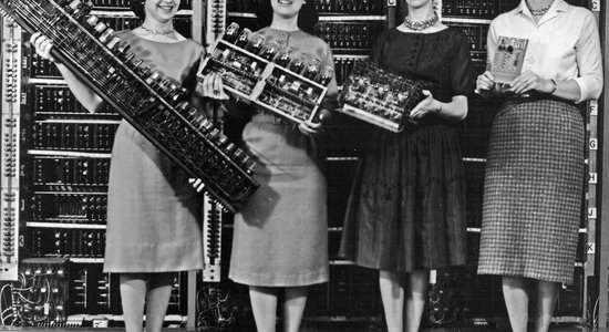 Lg women holding parts of the first four army computers